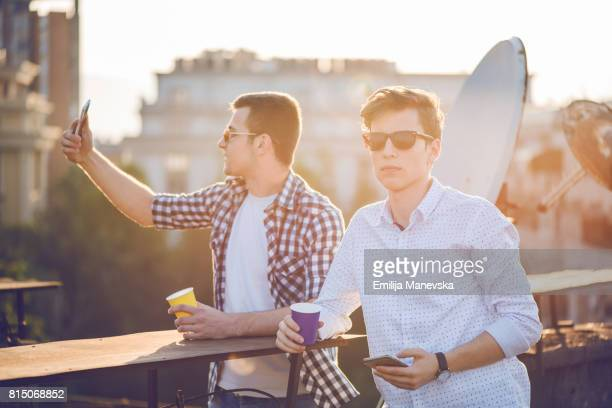 Two young men and social network concept
