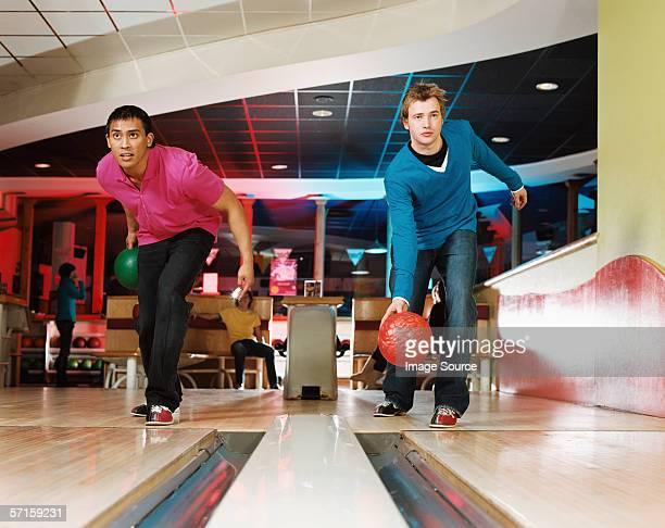Two young men bowling