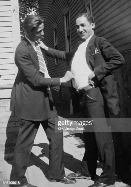 Two young men clown around with each other ca 1926