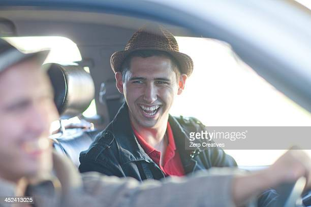 Two young men driving in car