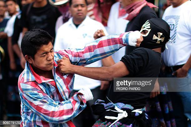 Two young men engage in battle a facet of the Xochimilcas fight to defend their women against the Aztecs in the Mexican municipality of Zitlala in...