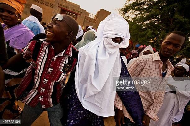 Two young men go through the Tuareg Chesh ceremony where each is ceremonially turbanned in front of their families by an elder man, on September 20,...