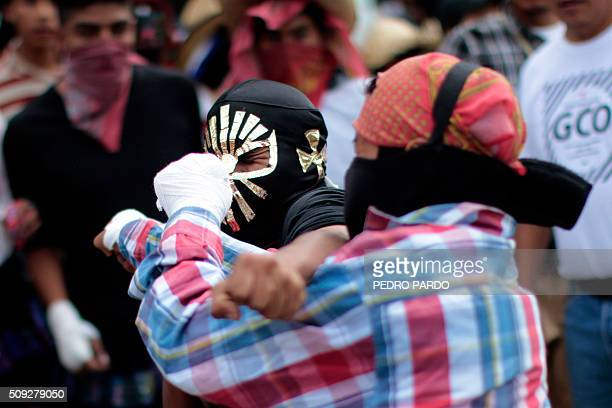 Two young men hit each other representing a facet of the Xochimilcas fight to defend their women against the Aztecs in the Mexican municipality of...