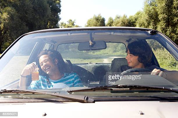 two young men in a car