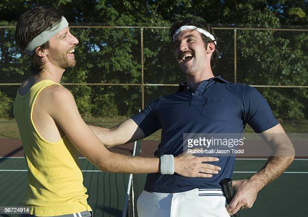 two young men laughing in a tennis court - ヘアバンド ストックフォトと画像