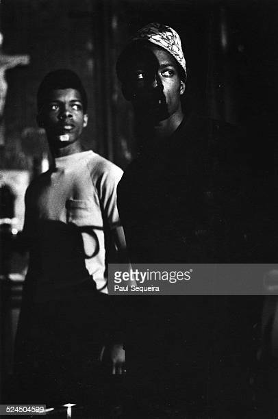 Two young men listen to Black Panther Party leader Fred Hampton speaking at the People's Church Chicago Illinois 1969