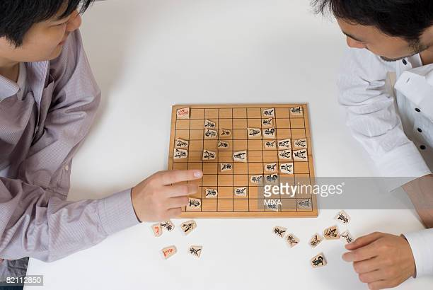 Two young men playing Japanese chess