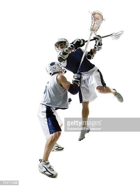 two young men playing lacrosse - lacrosse stock pictures, royalty-free photos & images