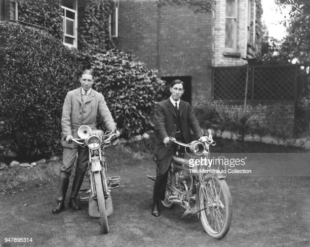 Two young men posing in an English country garden beside their motorcycles, the motorcycle on the right being the British made Triumph motorcycle and...
