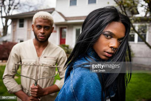 two young men posing in front yard - transgender man stock photos and pictures