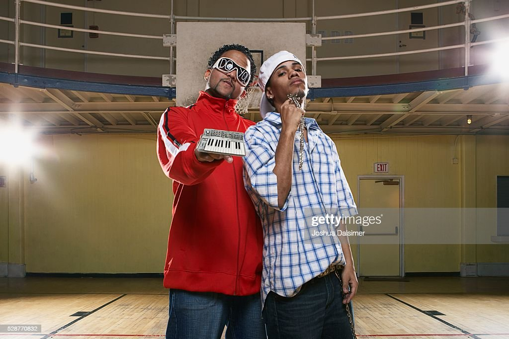 Two young men showing bling : Stock Photo