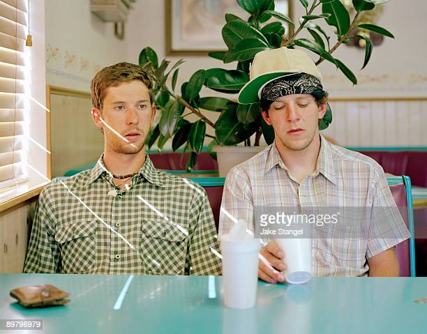 Two young men sitting in a diner