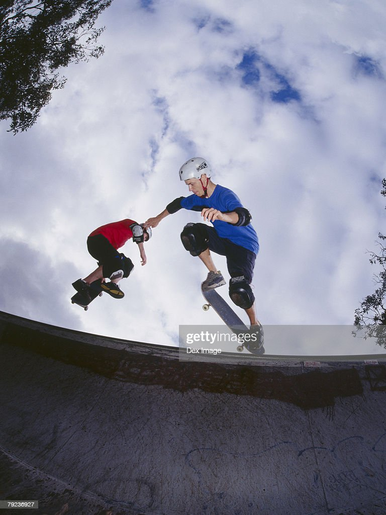 Two young men skateboarding on ramp : Stock Photo