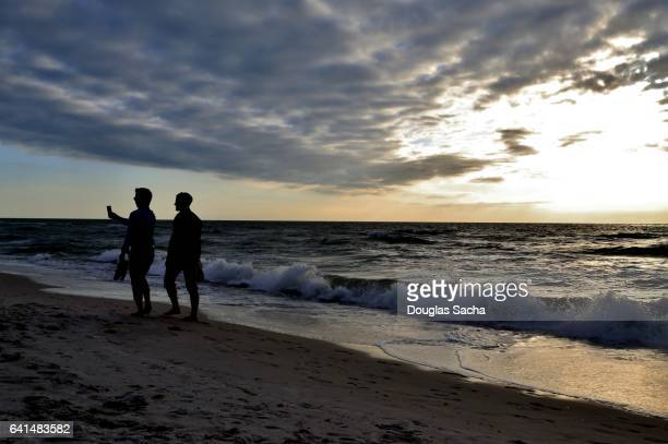 Two young men take a selfie on the beach, Naples, Florida, USA