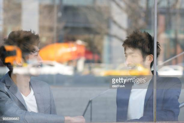 two young men talking - asian twins stock photos and pictures