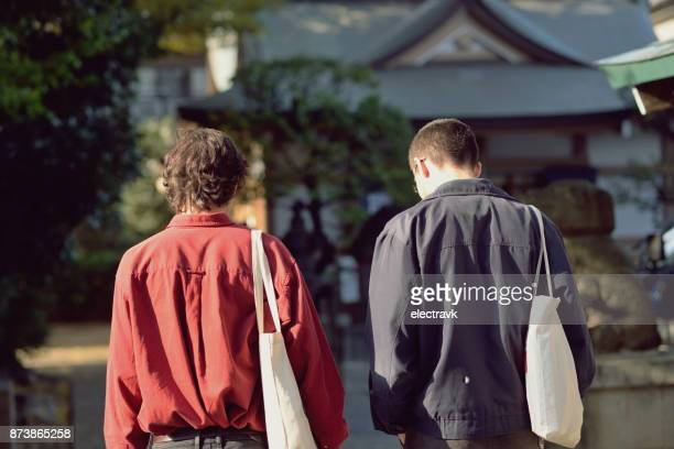 Two young men walking outside