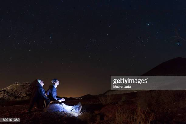 Two young men watching the starry sky