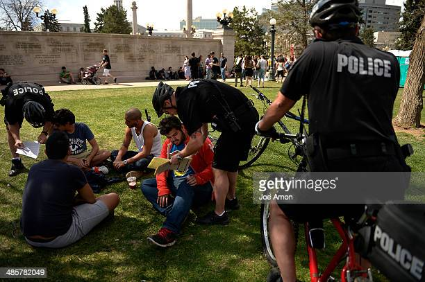 Two young men were ticked by bicycle policemen for smoking marijuana in public during the 420 celebration at the Denver 420 Rally in Civic Center...