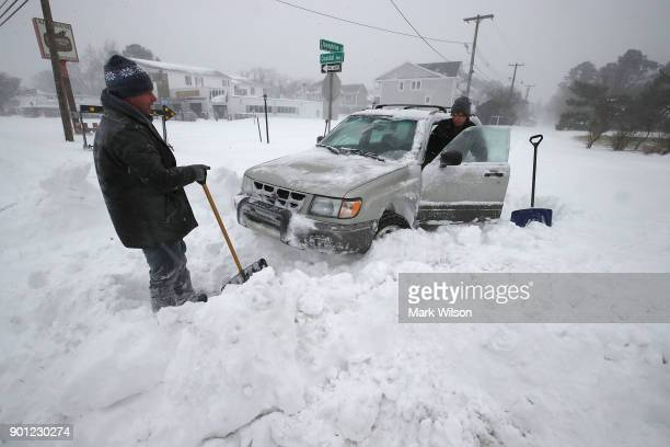 Two young men who wished not to be identified try to get their car unstuck after a storm passed the area on January 4 2018 in Rehoboth Beach Delaware...