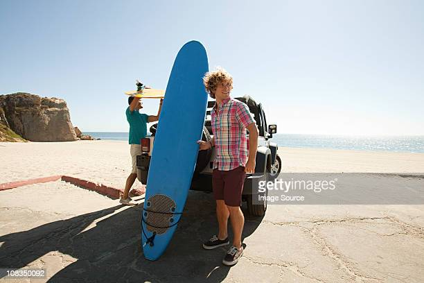 Two young men with surfboards