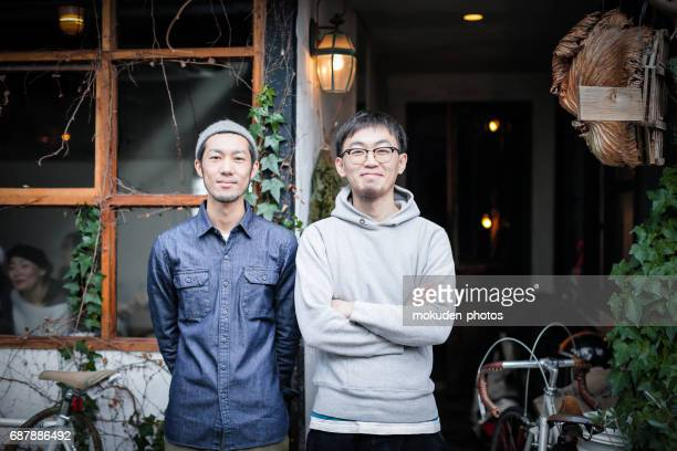 two young men's cafe owners of confident - 経済 stock pictures, royalty-free photos & images