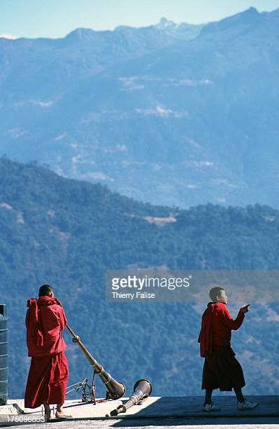 Two young monks on a roof of the Tawang monastery