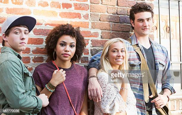 Two young multiracial couples hanging out together