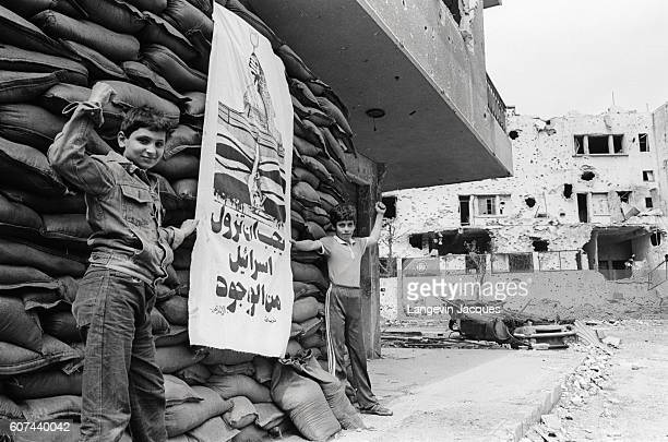 Two young Muslim boys stand near a Lebanese stronghold in Beirut Lebanon shortly before the 1984 withdrawal of the Multinational Forces In 1975...
