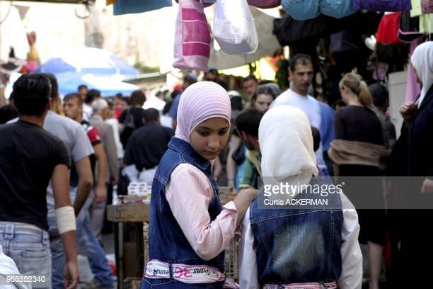 Two young Muslim girls go shopping in the Muslim Quarter of Jerusalem's Old City The Muslim Quarter derives most of the business from the IsraeliArab...
