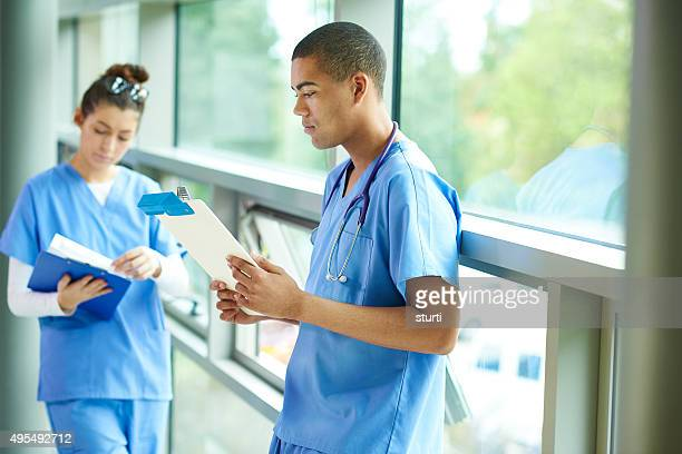 two young nurses on the ward - junior doctor stock pictures, royalty-free photos & images