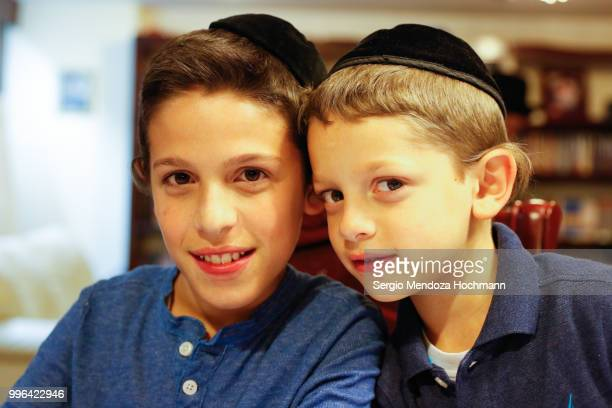 two young orthodox jewish boys smile and look at the camera - judaism stock pictures, royalty-free photos & images