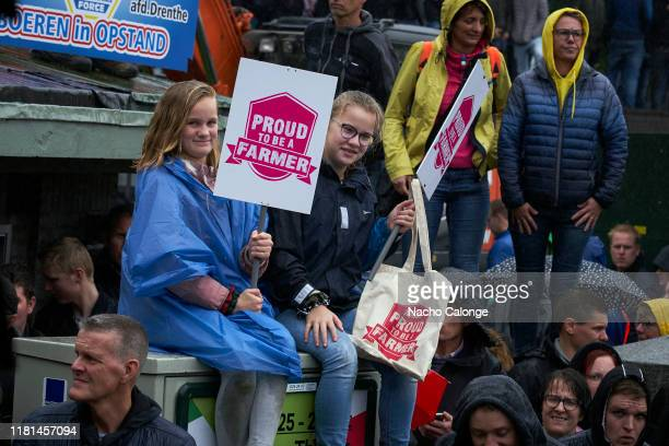 Two young people attend with their placards to protest at the demonstration on October 16 2019 in The Hague Netherlands A demonstration has been...