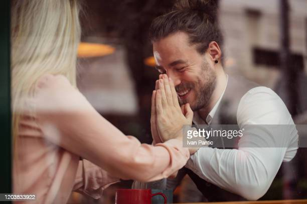 two young people on a date - forgiveness stock pictures, royalty-free photos & images