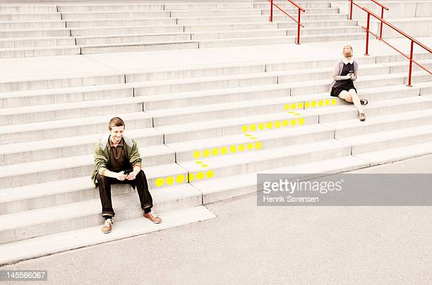 Two young people sitting on the stairway