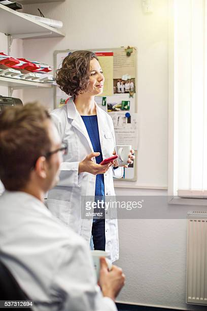 Two young pharmacists having a coffee break