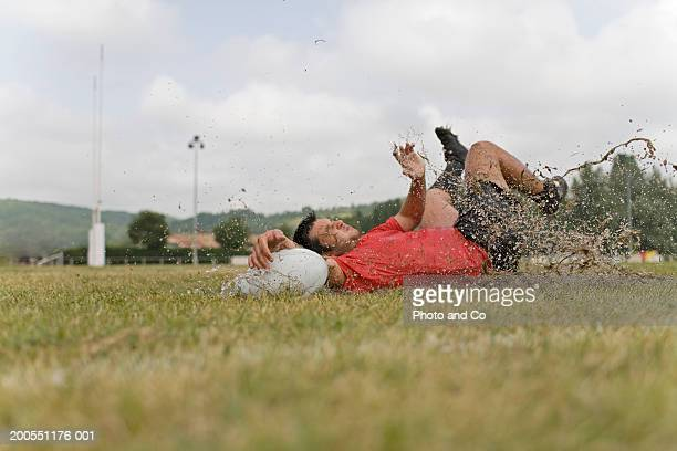 two young rugby players falling down into mud, ground view - face off sports play stock pictures, royalty-free photos & images
