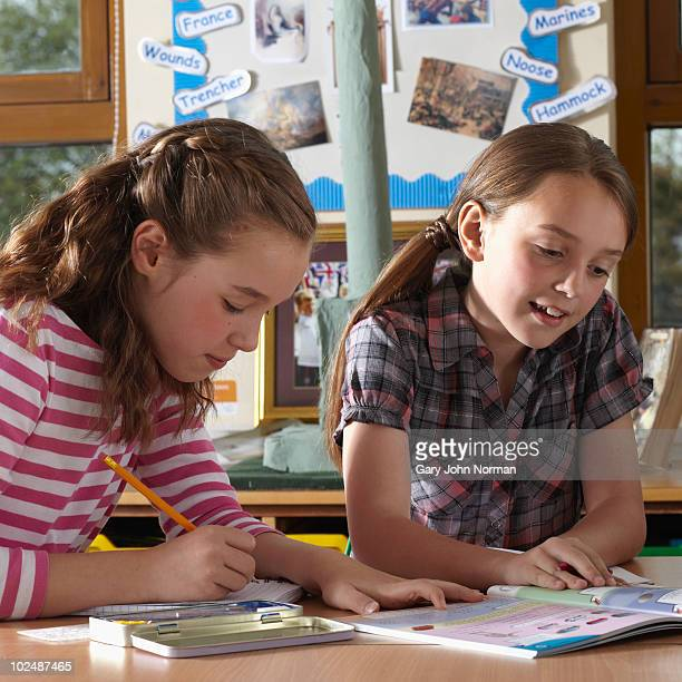 Two young school children working together