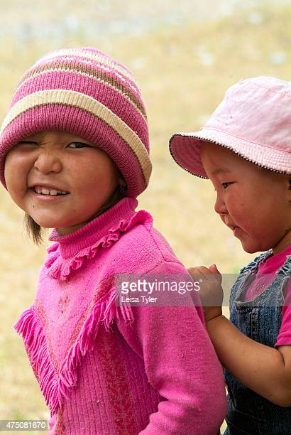 Two young shepherd girls in Kyrgyzstan. Sitting over 2000 meters and covered in snow in winter, in summer the transhumance Kyrgyz move to the...