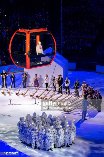 Two young singers on the gondola perform a verse of the Swiss national anthem in French during Opening Ceremony of the Lausanne 2020 Winter Youth...