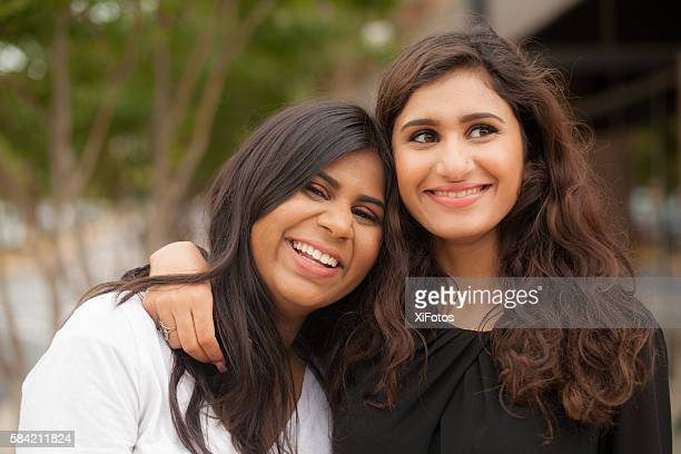 Two young sisters of South Asian ethnicity