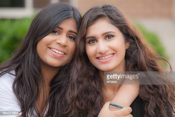two young sisters of south asian ethnicity - indian college girls stock photos and pictures