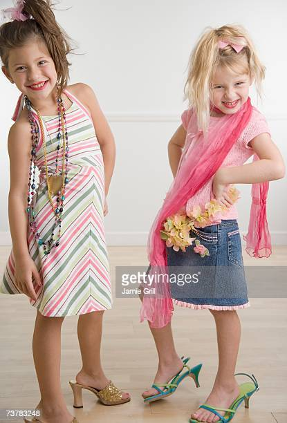 two young sisters playing dress-up - little girl in high heels stock photos and pictures