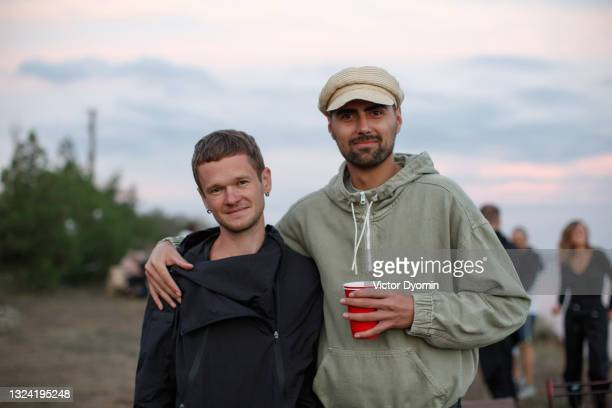 two young smiling men in the windbreakers - ukraine stock pictures, royalty-free photos & images