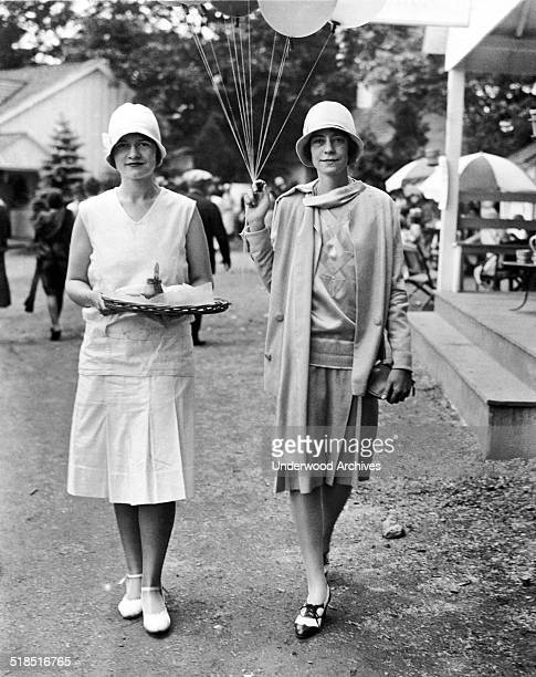 Two young society women who are selling hot dogs and balloons at the Devon Charity Horse and Dog Show for the benefit of Bryn Mawr Hospital Devon...