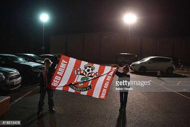 Two young Southampton fans hold their flag up outside the stadium prior to kick offf during the EFL Cup fourth round match between Southampton and...