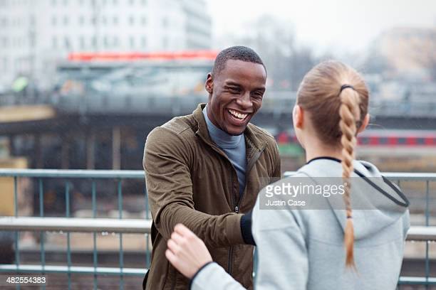 two young sporty friends laughing