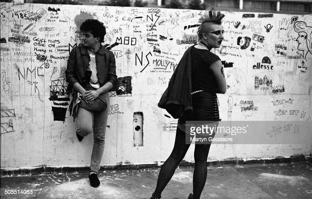 Two young squatters wearing punk fashions south London 1983