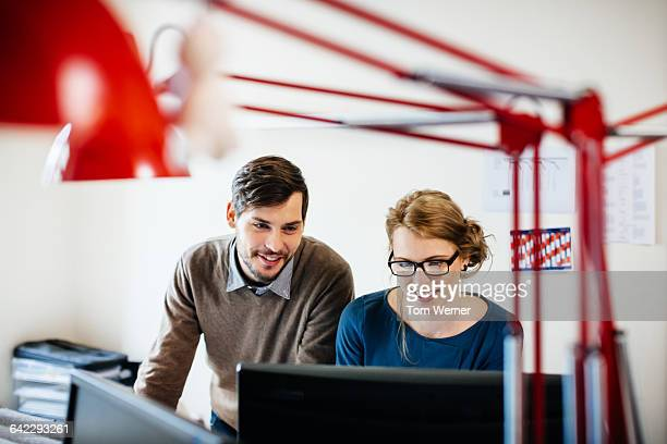 Two young start up people in their office