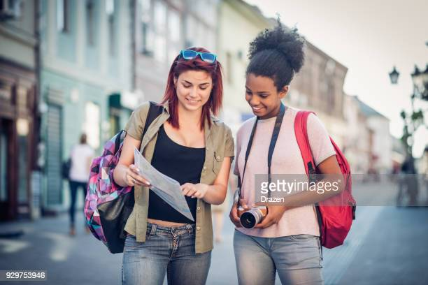 Two young students on student exchange looking for campus