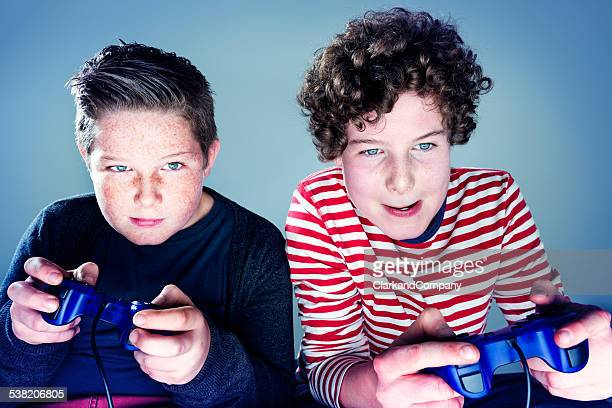 Two Young Teenage Boys Playing Video Game